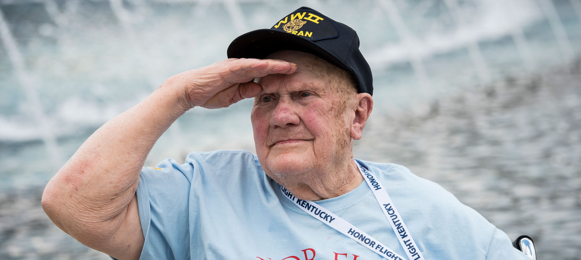 Honor Flight Vet salutes the flag